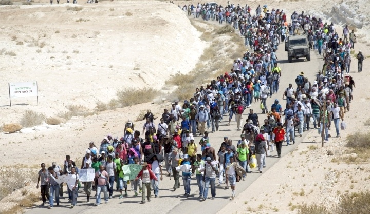 A year ago, 1,000 African asylum seekers marched out of the Holot detention facility toward the Egyptian border, hoping to draw the world's attention to their plight. Since then, thousands have been pressured to leave Israel. As protests appear ineffectual, two asylum seekers discuss what comes next. (Photo by Activestills.org)