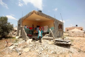 A destroyed home in Khan Younis, southern Gaza Strip, 2 July 2015. Ashraf Amra APA images.