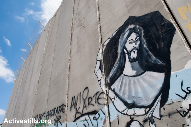BETHLEHEM, mural adorns the Israeli separation wall in Bethlehem. ActiveStills photo by Ryan Rodrick Beiler.