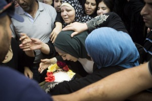 Picture caption: Family mourn during the funeral of Muhammad al-Kasbeh, shot dead by an Israeli commander in Qalandiya refugee camp, 3 July. Oren Ziv ActiveStills