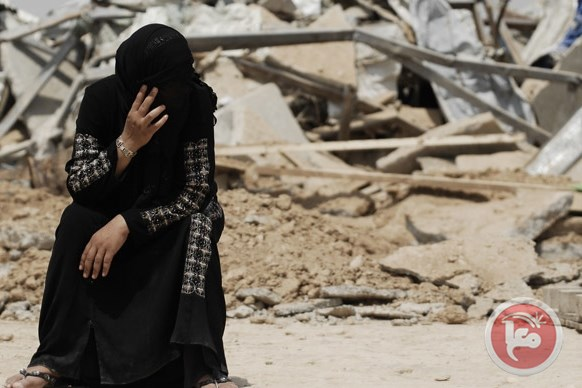 A Palestinian Bedouin in front of the ruins of her family house demolished by Israel in the Negev on August 4, 2010. (AFP/David Buimovitch)