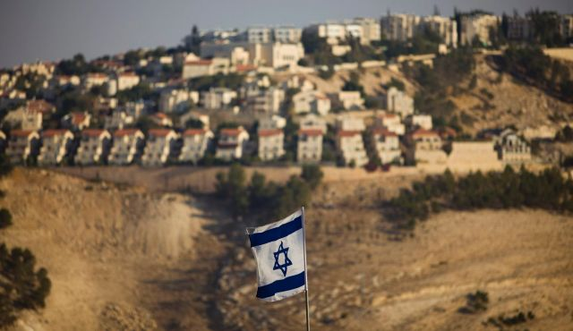 An Israeli flag is seen in front of the West Bank Jewish settlement of Maaleh Adumim. Photo by AP