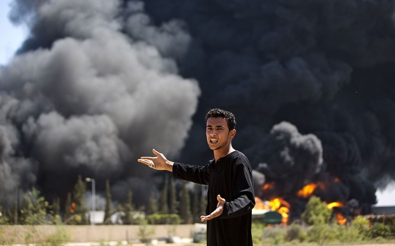 August 22, 2014. A Palestinian man reacts as a fire burns the only power plant supplying electricity to the Gaza Strip. Israeli shells struck the plant. (Photo: AFP/Getty Images)