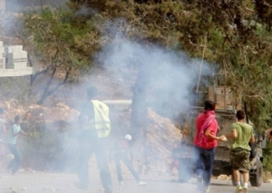The soldiers fired rounds of live ammunition, gas bombs and rubber-coated metal bullets; scores of residents suffered the effects of tear gas inhalation. (Photo IMEMC)