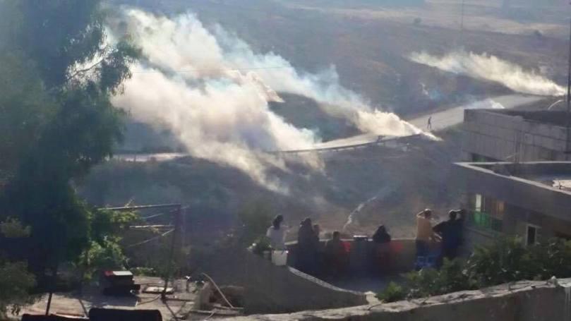 Caption: Clouds of tear gas in Nabi Saleh. (International Solidarity Movement, Nabi Saleh)