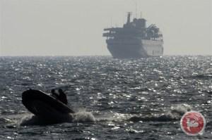 Caption: A boat escorts Turkish ship Mavi Marmara with Israeli forces near Ashdod on May 31, 2010, after the Israeli navy raided a flotilla of aid ships bound for Gaza. (AFP/ Menahem Kahana, File)