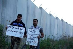 Caption: Palestinians on the West Bank appeal for the Feis to be cancelled Photo: Hamza Burnat