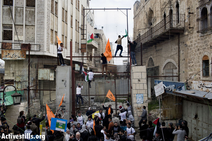 Activists from Youth Against Settlements (YAS) group in Hebron demonstrating against blockade of al-Buera's main street.