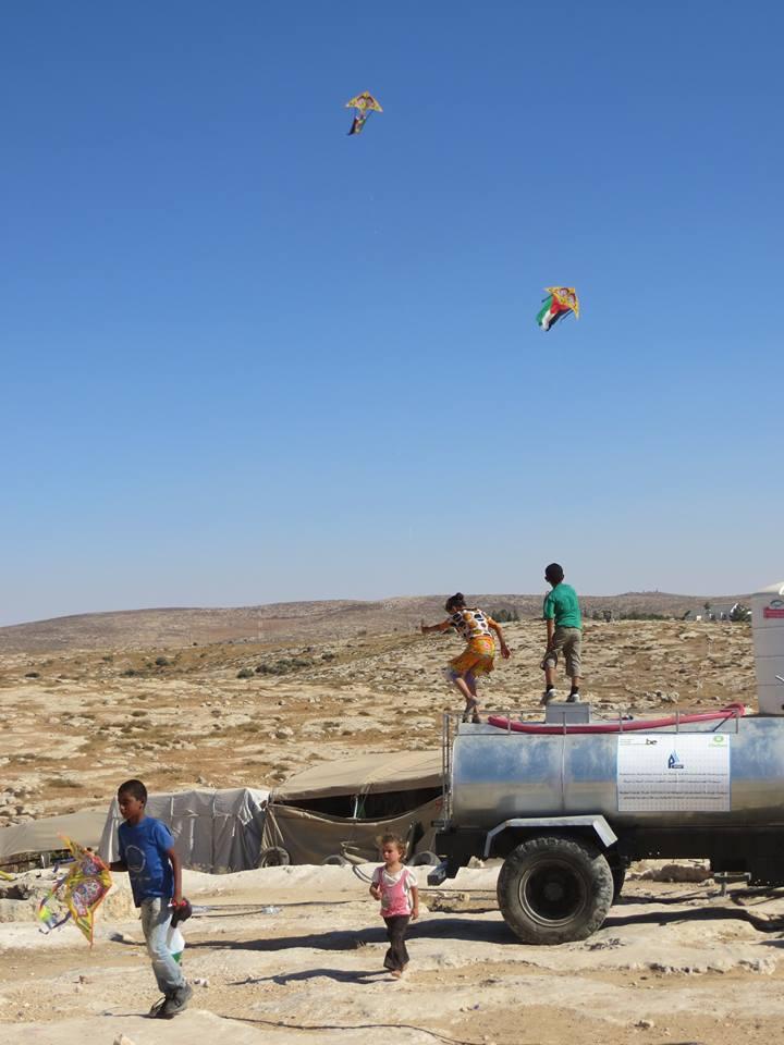 Children flying kites in Susiya, August 12, 2015. From: Susiya Forever Community, Facebook.