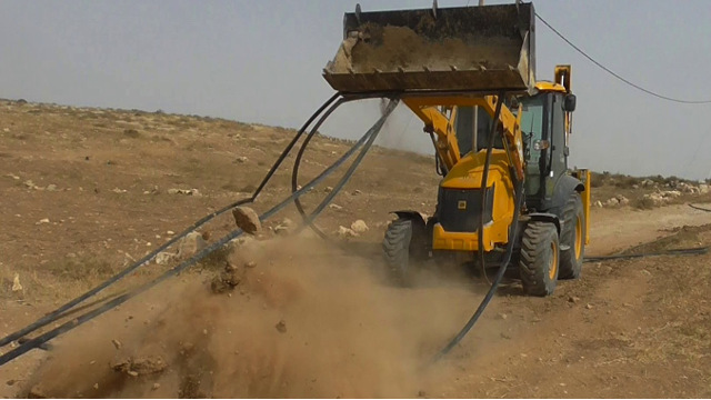 "(Story in ""Home Demolition"" Page above.) In Umm Dirit, a 900 square meter fence was destroyed with the villagers' sheep inside. The fence was  on Palestinian land, a few meters from an Israeli settlement outpost."