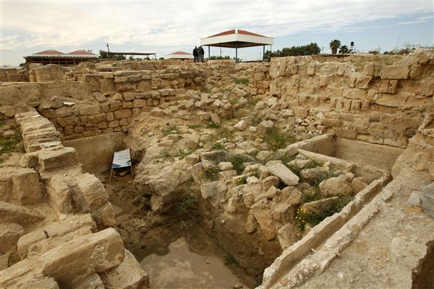A picture taken on March 19, 2013 shows workers at the archaeological site of the Saint Hilarion Monastery, one of the largest Christian monasteries in the Middle East, in Tel Umm al-Amr close to Deir al-Balah, in the central Gaza Strip. AFP photo. More. . .