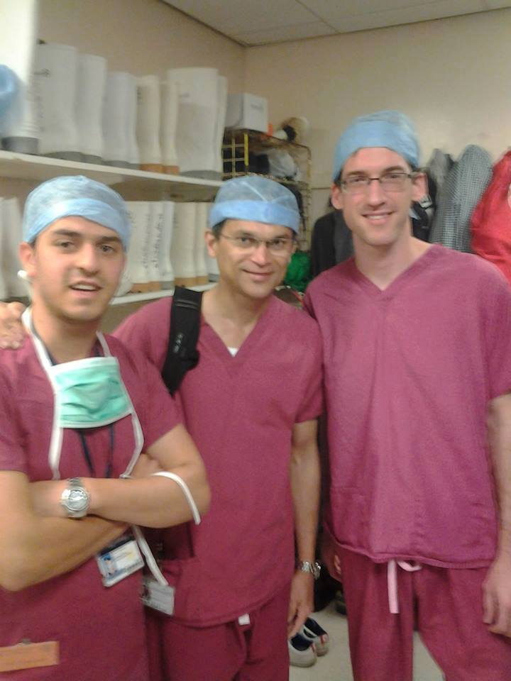 Said al-Yacoubi (far left), with two members of the Oxford transplant team.