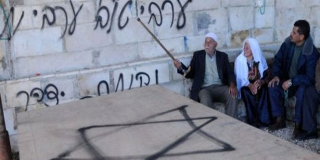 Extremist settlers spray racist slogans on walls of homes and shops in East Jerusalem (Photo from Al-Quds newspaper)