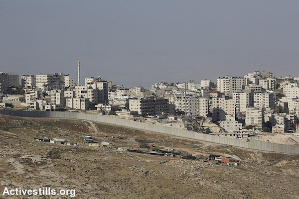 The separation wall surrounds a Palestinian neighborhood of East Jerusalem,