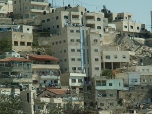 Beit Yonatan building, named for Jonathan Pollard, the American convicted of spying for Israel and jailed in 1987. The tall building draped in a gigantic Israeli flag. Photo Settlement Watch of Peace Now.