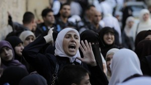 A Palestinian woman shouts after being blocked by Israel security forces from entering the Al-Aqsa Mosque compound. October 13 2014. Photo credit AFP Ahmad Gharabli