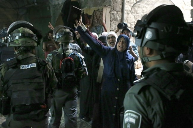 Palestinian women demonstrate in an alley outside the Al-Aqsa Mosque compound in Jerusalem's Old City on September 14, 2015. (AFP/Thomas Coex)