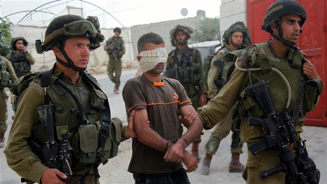 File photo shows Israeli forces arresting a young Palestinian near the occupied West Bank city of al-Khalil near Hebron. (PressTV photo)