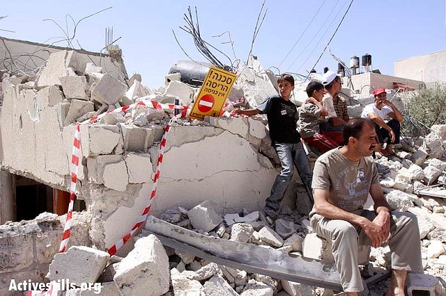 House demolition in A-Tur, East Jerusalem, June 2009. A Day after the municipality of Jerusalem announced it'd stop demolishing homes in East Jerusalem, Abu-Jumaa's house in A-Tur was demolished (Photo: Activestills)