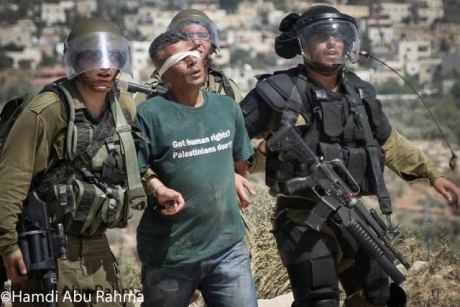 Iyad Burnat's chilling account of the torture and beatings suffered at the hands of Israeli soldiers after being detained at the weekly protests in Bil'in.
