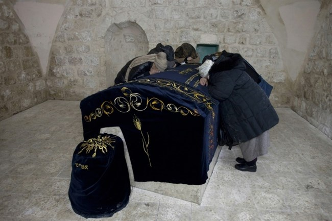 Jewish women and settlers pray at the Tomb of Joseph in the northern Palestinian city of Nablus. AFP File/Menahem Kahana.
