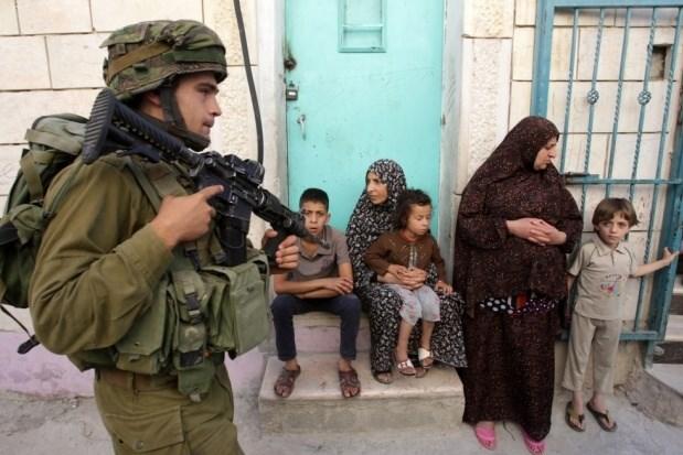 Assault rifles versus rocks. (AFP/File)