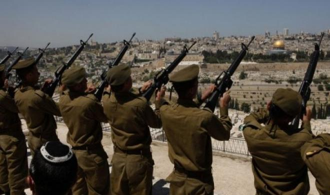 Israeli soldiers at the military cemetery on the Mount of Olives in Palestinian East Jerusalem. Gali Tibbon AFP file.