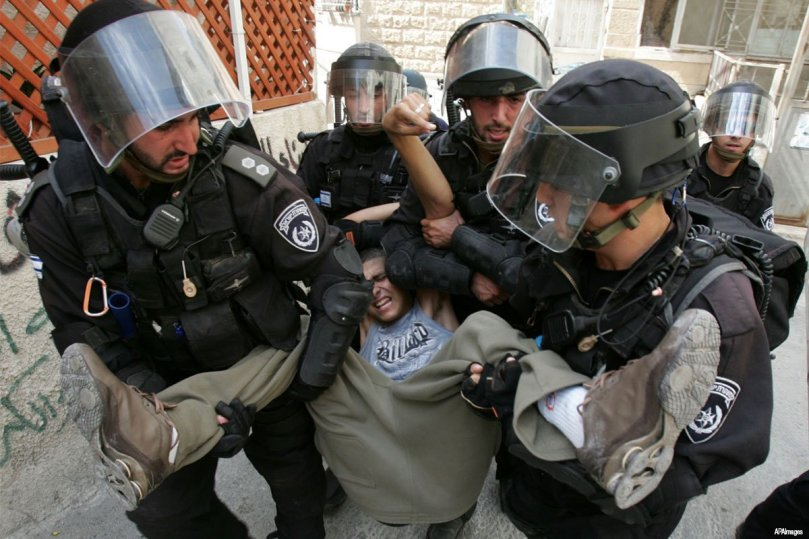 If it were not so outrageous and tyrannical, it would be comical. Palestinian young person being arrested by Israeli forces for alleged stone throwing. Three to one, and the one is a child. (APF file photo)