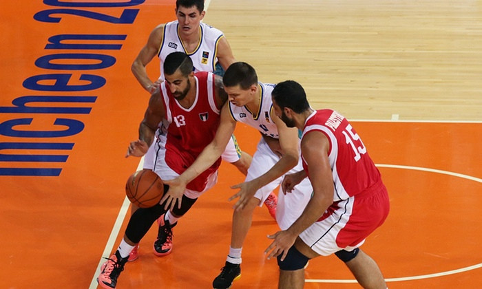 Sani Sakakini (No13) is an instrumental part of Palestine's rise in basketball. Photograph: Chung Sung-Jun/Getty Images