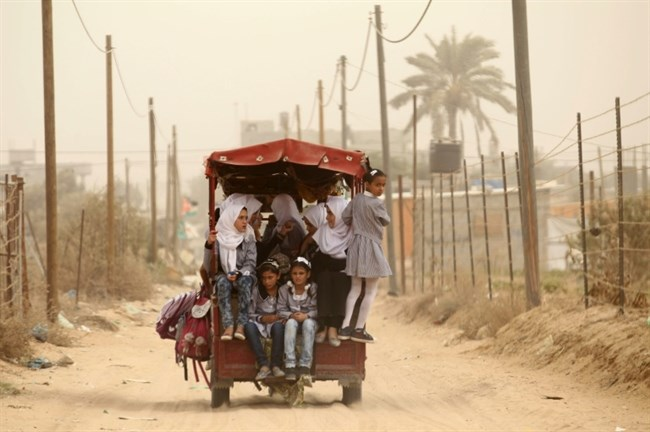 "WORLD BANK: ""Increasing poverty in the occupied Palestinian territory."" Palestinian school children ride a rickshaw in Khan Younis in the southern Gaza Strip on September 9, 2015. (Agence France‑Presse /Said Khatib/File)"