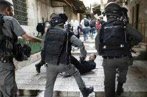 A Palestinian lies in an alley leading to the Al-Aqsa mosque compound in Jerusalem's Old City after scuffles with Israeli riot police on September 14, 2015 (AFP/Thomas Coex, File)