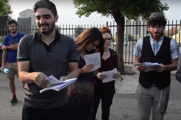 Jewish anti-occupation activists hand out flyers to delegates at the World Zionist Congress, Jerusalem, October 20, 2015. (Photo: Laura Gottesdiener). See number ❸ below.