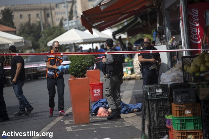 The body of a Palestinian teen is seen on the street near Damascus Gate, Jerusalem, October 10, 2015. The teen, later identified as Ishaq Badran, 16, from Kafr Aqab, was shot and killed by the Israeli police after carrying out an alleged stabbing attack in the area. (Photo: Anne Paq/Activestills.org)