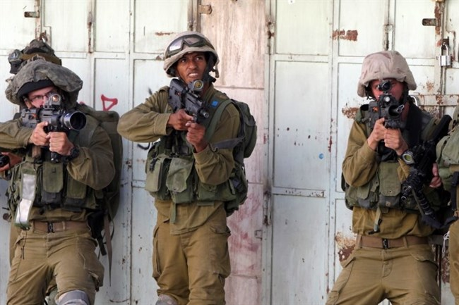 Israeli soldiers as they appear confronting unarmed Palestinian civilians throughout the Occupied Territories and East Jerusalem. (Agence France‑Presse/Photo)