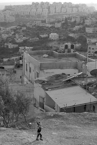In the foreground is the Palestinian neighborhood of Sur Baher. Behind it on the hilltop is the Israeli settlement of Har Homa. (Photo: Yoav Galai). See Number ❸ below.
