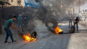 Palestinians burn tires during clashes with Israeli troops at Qalandia checkpoint between Jerusalem and the West Bank city of Ramallah, Tuesday, Oct. 6, 2015.  (AP Photo.) NOTE: There is no mention of what the Israeli troops did to bring this about.