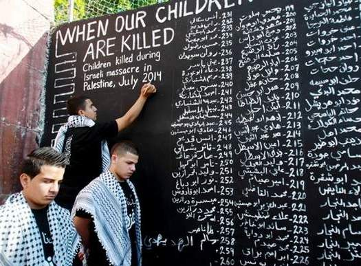 Palestinian youths in Aida refugee camp list the names of the children killed in the Israeli military assault on the Gaza Strip, on July 28, 2014. (Photo: Agence France Presse/Musa al-Shaer, File)