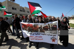 A group of demonstrators near the city of Qalqilya in the West Bank protest the closure of the Azzun village road by Israeli security forces on February 26, 2015. (Photo: Getty Images)