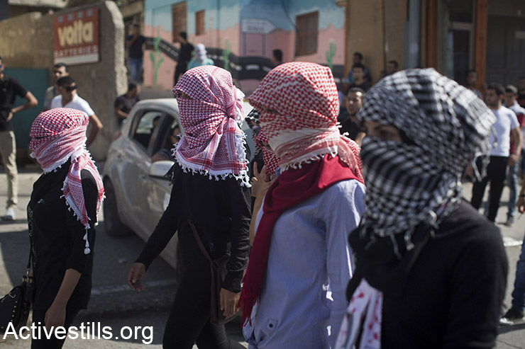 Young Palestinian women protesters march, during clashes with Israeli forces, in the West Bank city of Bethlehem, October 14, 2015. (Activestills.org)