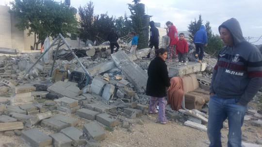 Residents of al-Walaje survey the destruction following the demolition of three homes in the village overnight on Tuesday, April 12, 2016. (Photo: +972 Magazine, April 14, 2016)