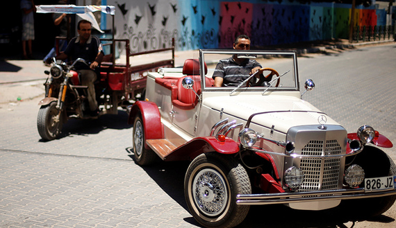 Palestinian Munir Shindi drives a replica of 1927 Mercedes Gazelle that he built from scratch, on a street in Gaza City