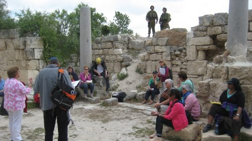 Israeli tourists, guarded by soldiers, visit the Roman site of Sebastiya, near Nablus, in the occupied West Bank (Photo: Jonathan Cook)