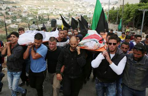 Mourners carry the bodies of Palestinian woman Maram Abu Ismail and her brother Ibrahim Taha